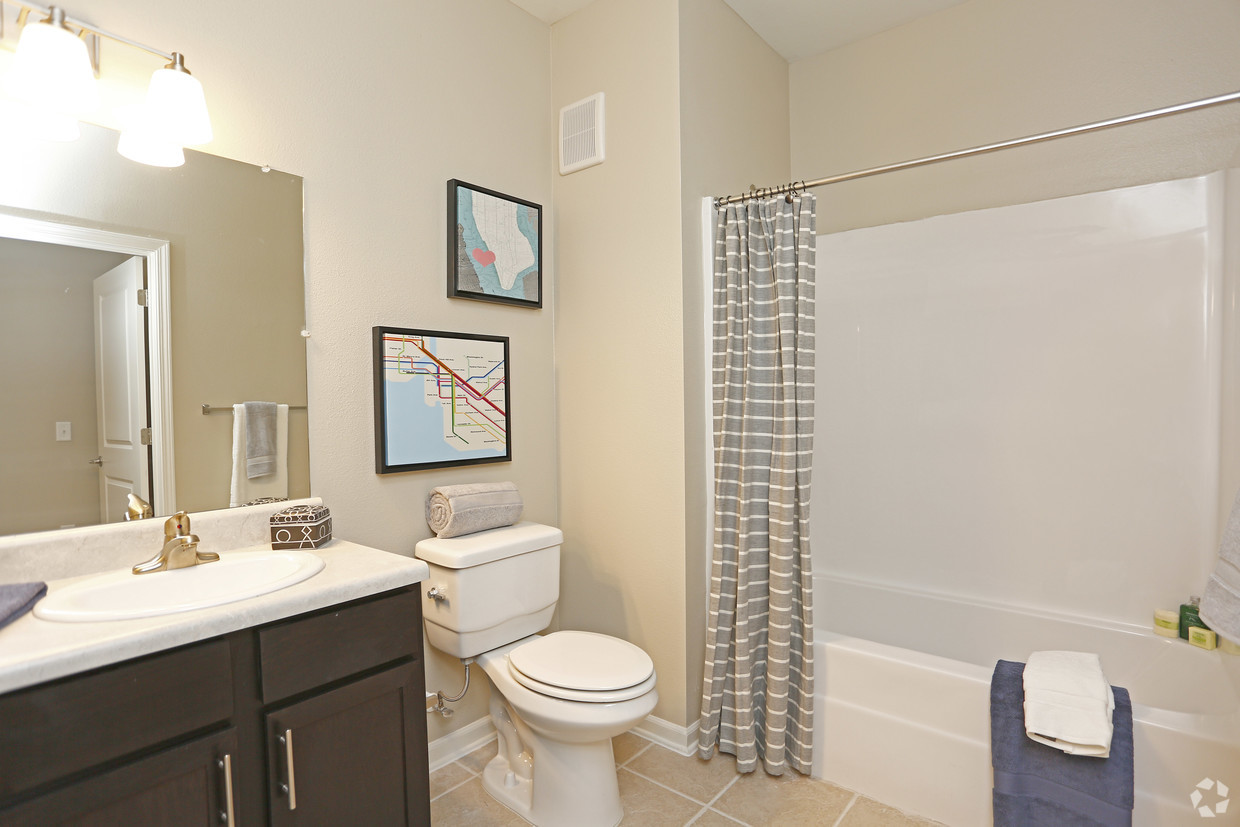 The Villages at Fiskville senior apartments bathroom with tile flooring
