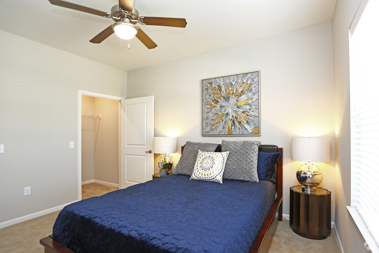 Master bedroom at The Villages at Fiskville with queen bed and blue comforter