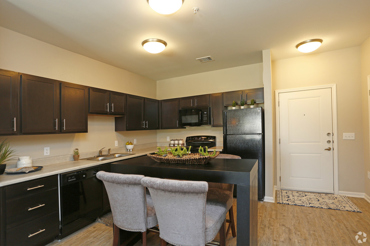 The Villages at Fiskville kitchen with wood cabinets and hardwood floors
