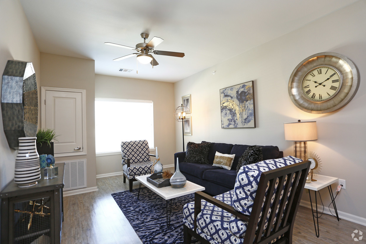 The Villages at Fiskville living room with navy furniture