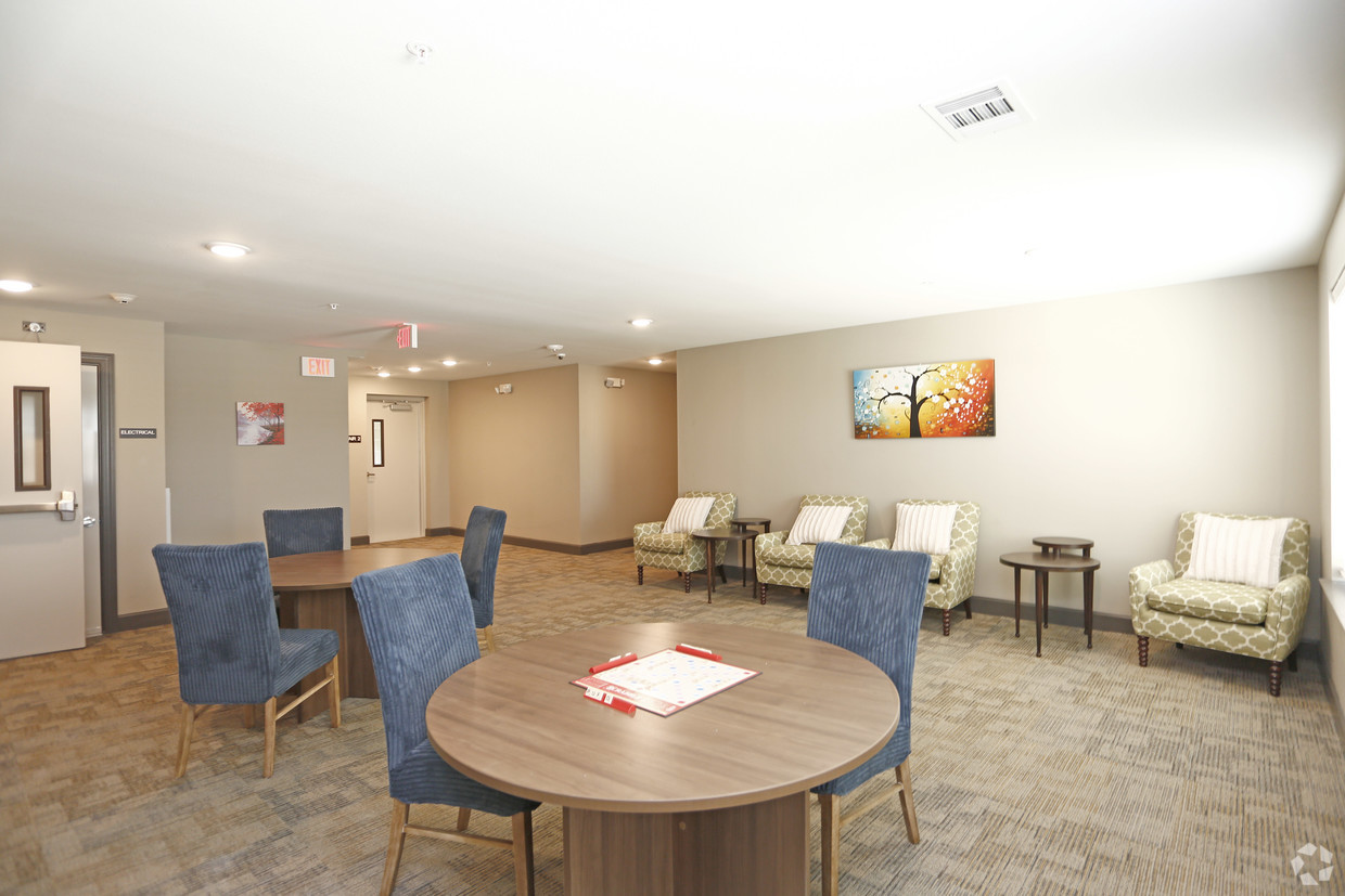 Community room at The Villages at Fiskville with tables and chairs