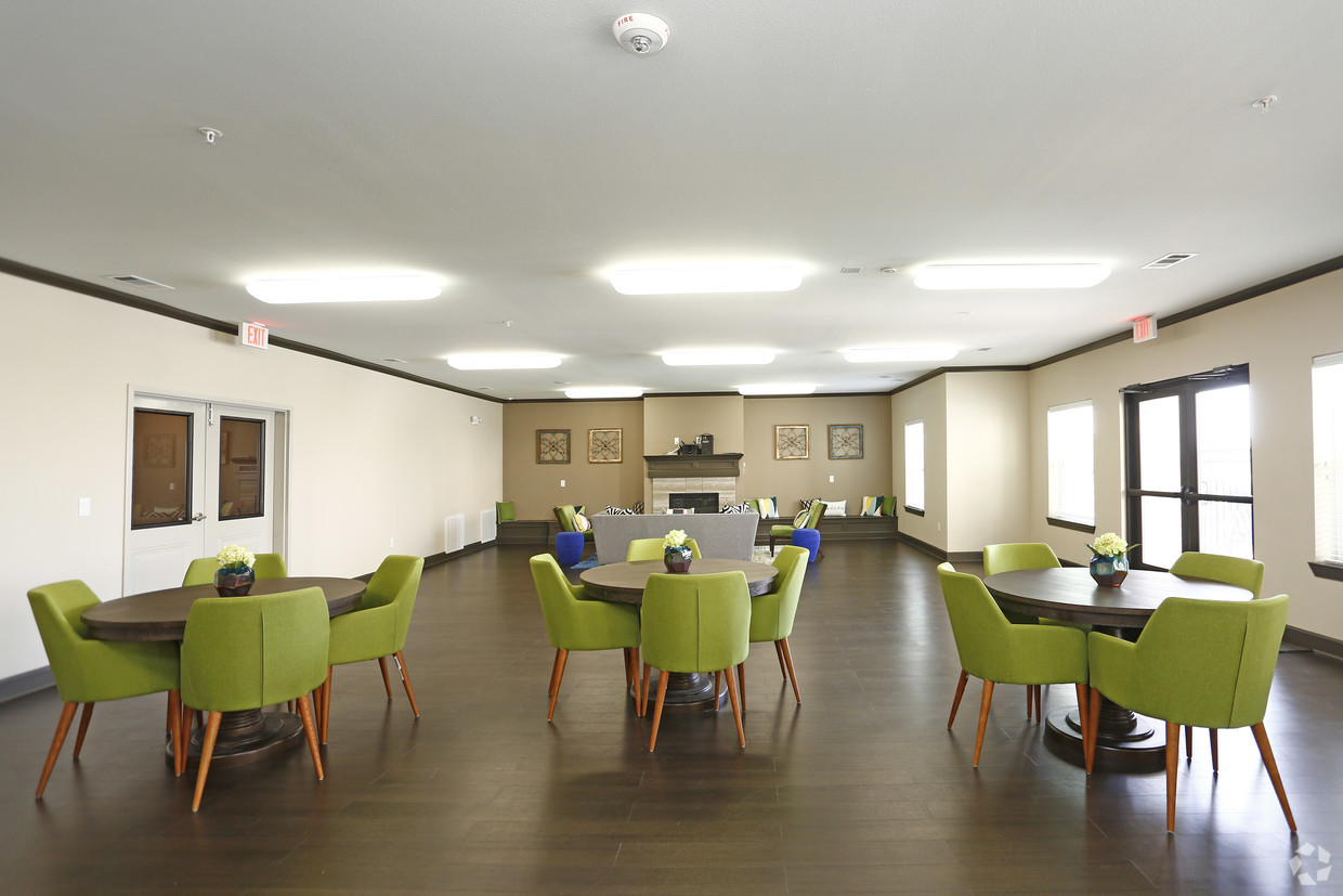 Community center at The Villages at Fiskville with tables and green chairs