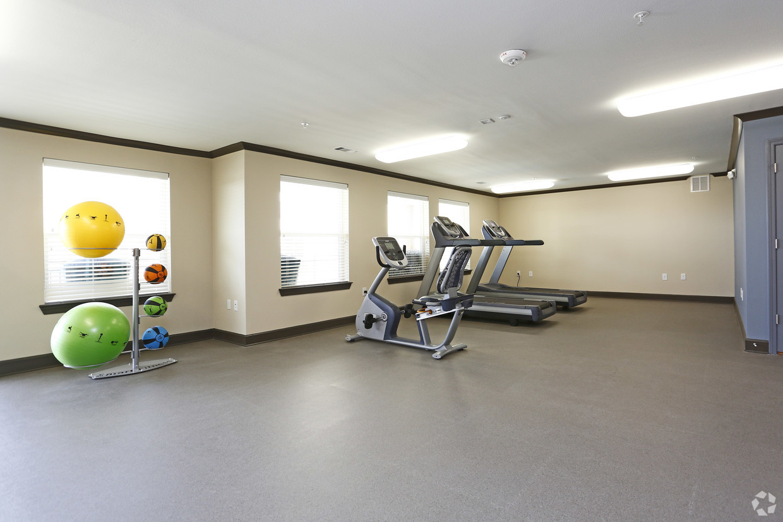 Villages at Fiskville fitness center with treadmills, stationary bike, medicine balls, and bosu balls