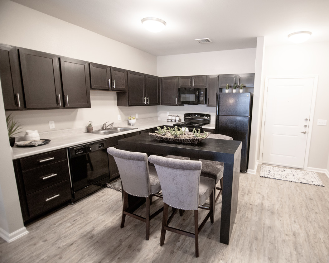 Kitchen area at The Villages at Fiskville retirement community with center island seating